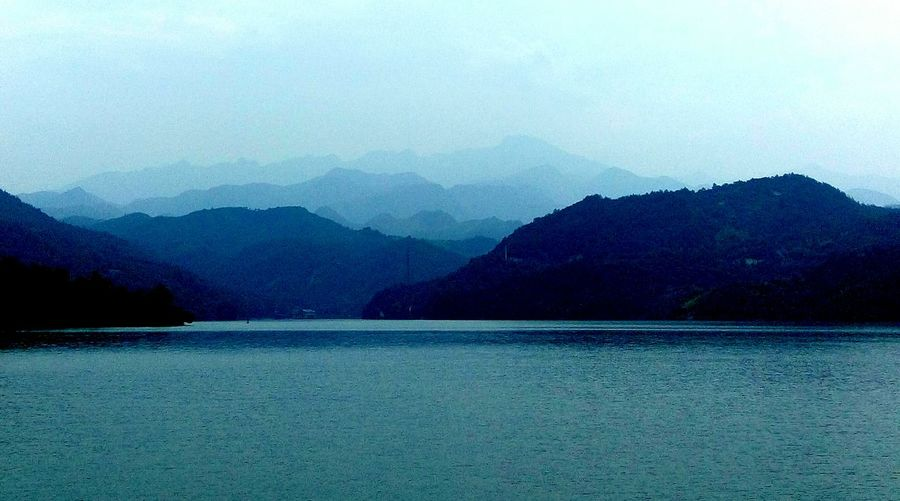 Mountain Water Tranquil Scene Scenics Tranquility Waterfront Beauty In Nature Mountain Range Lake Nature Blue Idyllic Non-urban Scene Sky Sea Majestic Outdoors Water Surface In Front Of Cloud - Sky