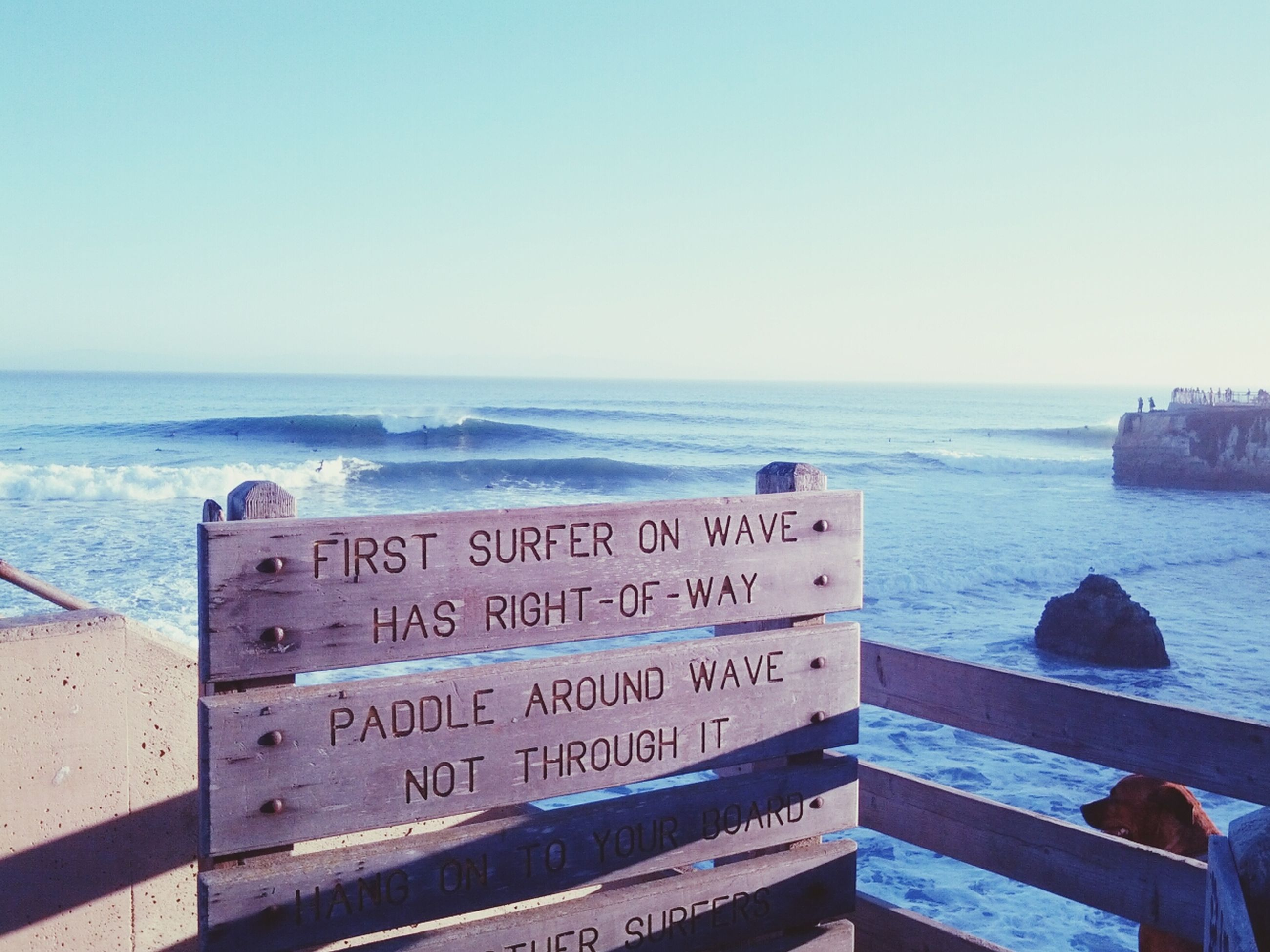 sea, text, horizon over water, water, western script, beach, clear sky, communication, shore, tranquility, scenics, nature, tranquil scene, copy space, day, beauty in nature, sky, non-western script, outdoors, information sign