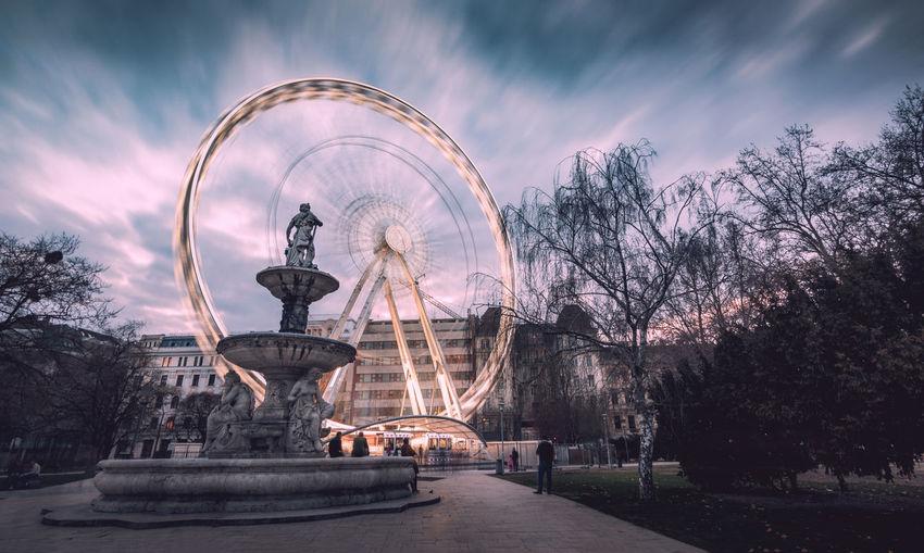 Ferris wheel against sky at dusk