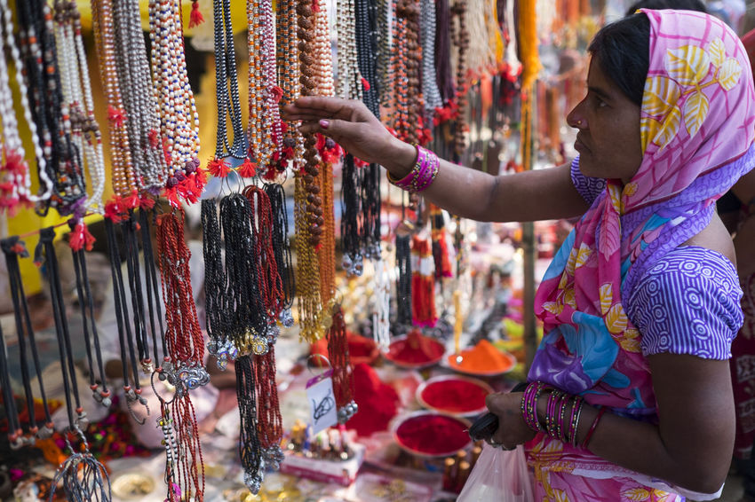 A woman checking out the necklaces and jewellery for sale at Sonepur Mela, Bihar Bangle Bihar Choice Choice Hajipur Happiness Human Arm Human Hand India Market Market Stall Money Multi Colored One Person Purchase Retail  Shopping Sonepur Sonepurmela Spend Temptation Travel Travel Photography