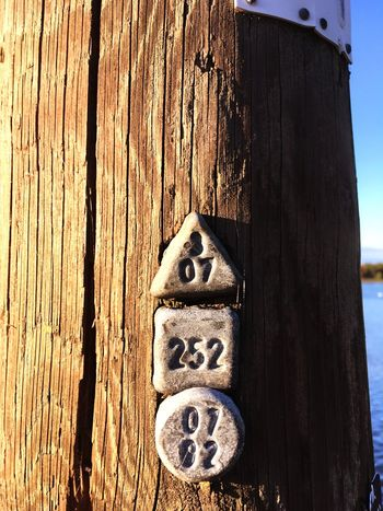 EyeEm Selects Technology - Wooden Pole of Powerline - Markings Wood - Material Day No People Outdoors Close-up Nature