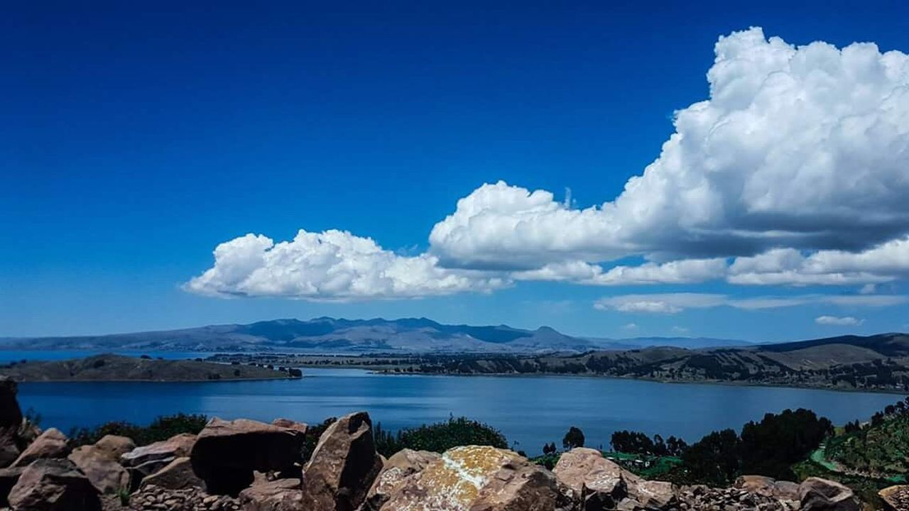 sky, nature, beauty in nature, scenics, tranquil scene, cloud - sky, mountain, tranquility, day, blue, rock - object, outdoors, water, no people, landscape, sea