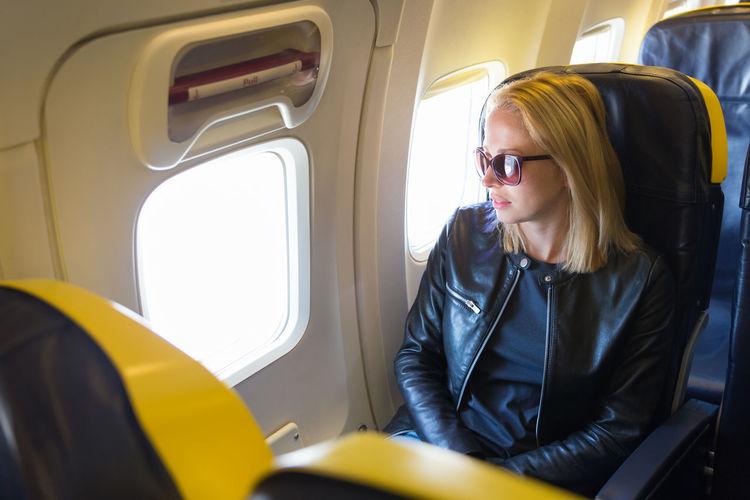 Beautiful woman sitting at airplane