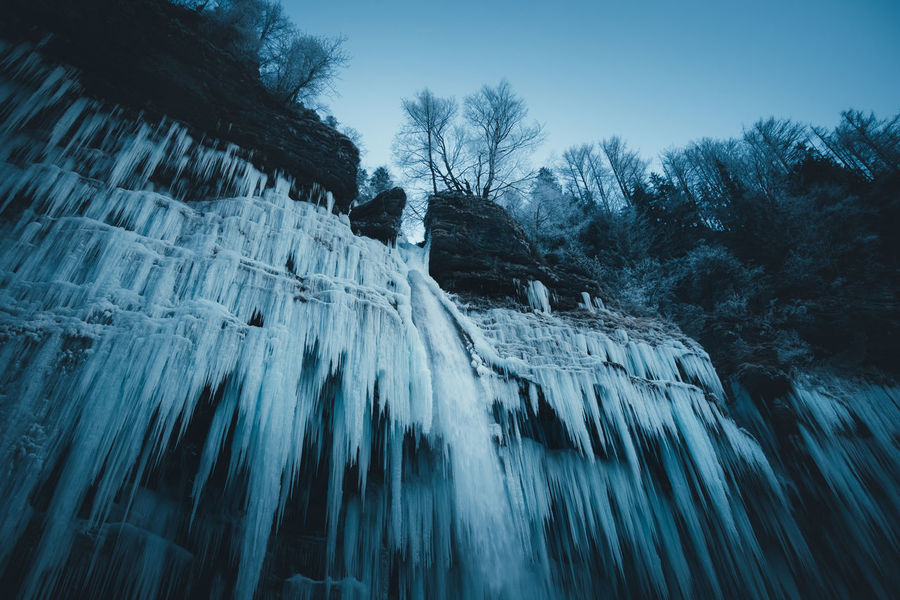 Icicles of frozen waterfall (Pericnik waterfall, Slovenia). Alps Beauty In Nature Cold Temperature Day Frozen Ice Icicles Landscape Mountain Nature No People Outdoors Peričnik Scenics Sky Slovenia Snow Stream Temperature Tranquil Scene Tranquility Tree Water Waterfall Winter