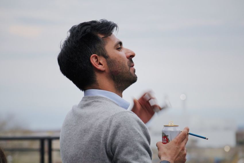 The Portraitist - 2017 EyeEm Awards Food And Drink One Person Focus On Foreground Drink Food Drinking Eating Holding Lifestyles Leisure Activity Real People Outdoors Men Bad Habit Headshot Young Adult Day One Man Only Water Close-up Rainy Days Toronto Canada Cigarette