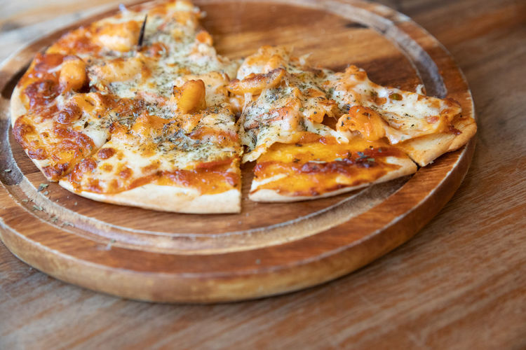 Food And Drink Pizza Food Cheese Wood - Material Freshness Dairy Product Indoors  Table Close-up Ready-to-eat Unhealthy Eating No People Italian Food Still Life Fast Food Indulgence Vegetable High Angle View Snack French Food Temptation