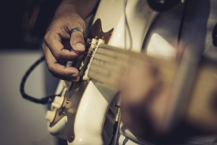 Artist Arts Culture And Entertainment Guitar Hand Human Body Part Human Hand Music Musical Equipment Musical Instrument Musician One Person Playing Plucking An Instrument Real People Selective Focus Skill  String Instrument