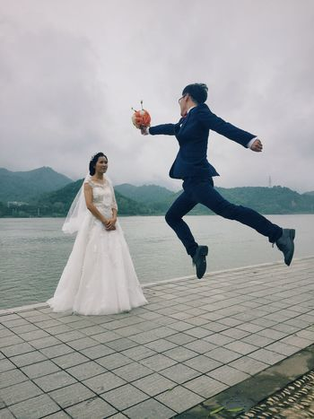 EyeEm Nature Lover EyeEm Best Shots Check This Out People Photography Today's Hot Look Getting Inspired Beautiful Surroundings Marriage  Love Romantic People Enjoying Life Bride Wedding Jump Water Jumping Person Couple Water Reflections jumping high