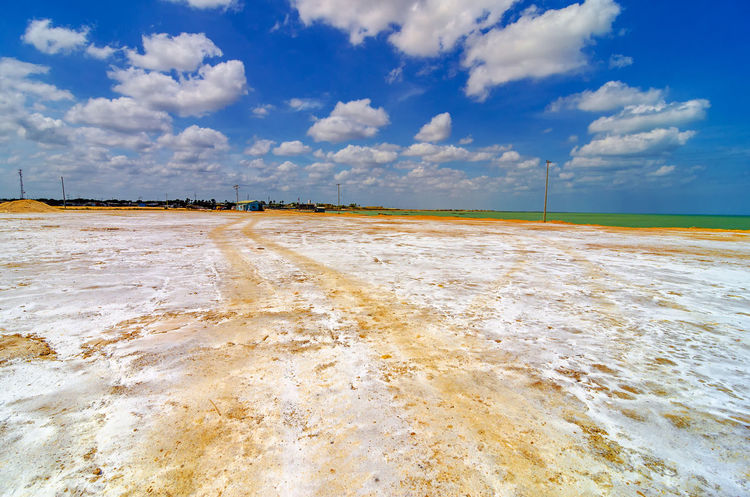White salt covered coast of Manaure in La Guajira, Colombia Blue Blue Sky Clouds Colombia Day Factory Food Hill Industrial Industry Laguajira Mana Mine Mineral Mining Outdoors Production Refinery Riohacha Salt Seasoning Sky Town White Work