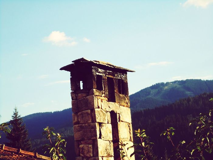 Old style Old-fashioned Travel Tradition Tourism Tower Travel Destinations Business Finance And Industry No People Clock Tower Architecture Vacations Archival Outdoors Clock History Day Tree Mountain Sky Architecture Beauty In Nature Built Structure Cloud - Sky Building Exterior First Eyeem Photo