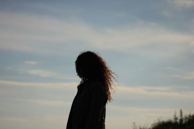 Side view of a girl against the sky
