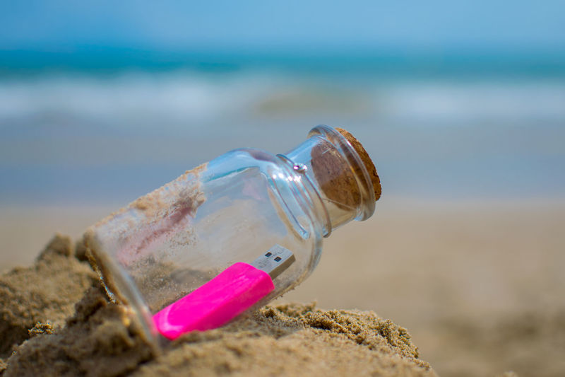 USB USB Flash Drive Beach Bokeh Bottle Close-up Conceptual Image Data Storage Day Help Message Message In A Bottle New Technologies No People Outdoors Pen Drive Rescue Sand Sea Selective Focus Shoreline Sos Technological Advances The Times Change Water