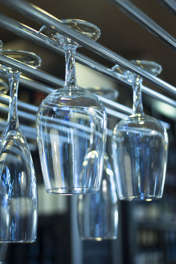 Close-up of wine glasses on table
