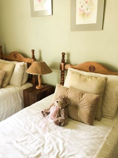 Teddy bear in bed at home