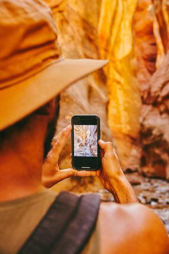 Human hand holding smart phone