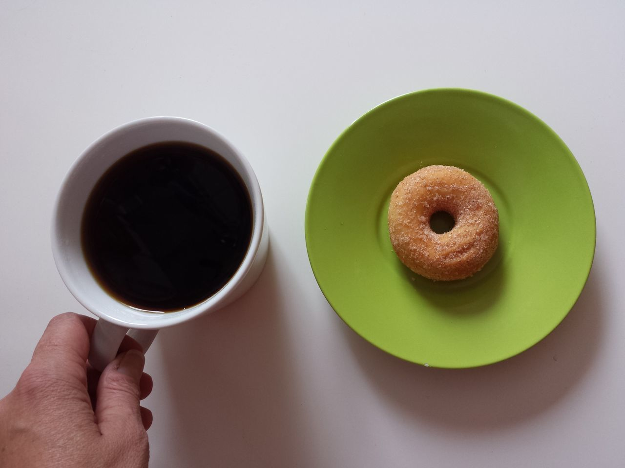 Person having coffee and donut