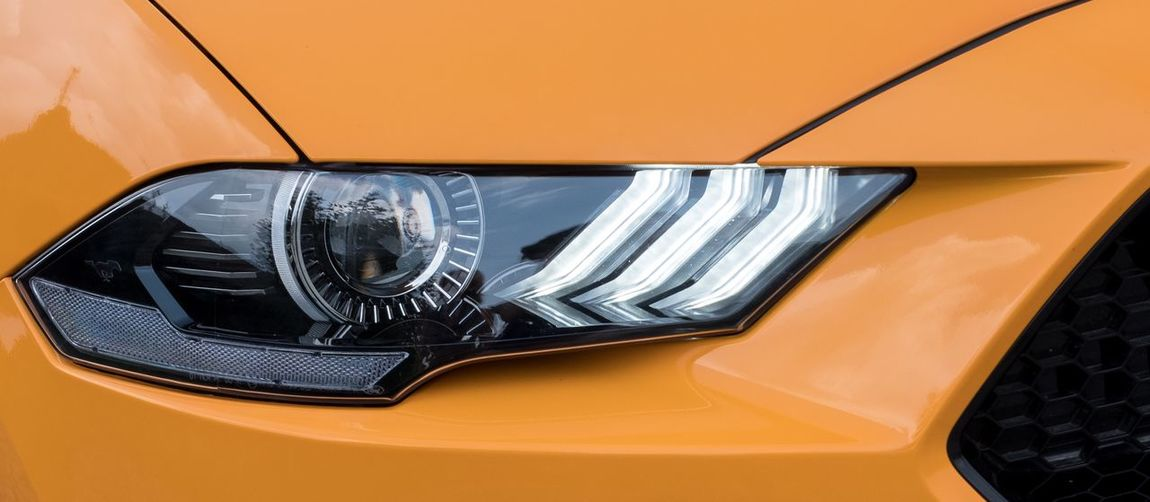 Ford mustang headlight Ford Mustang Ford Mustang Orange Color Yellow Transportation Car Motor Vehicle Mode Of Transportation Land Vehicle No People High Angle View Close-up Metal Outdoors Glass - Material Stationary Day Headlight Clean