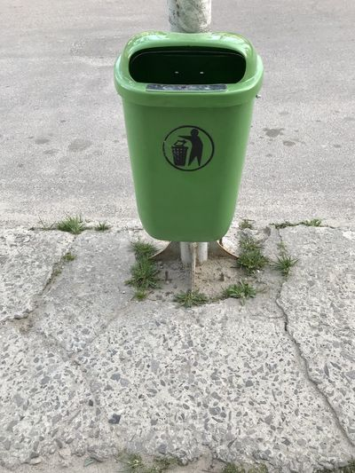 High angle view of garbage bin on street