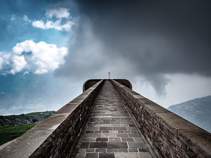 Sky Architecture Cloud - Sky Built Structure Direction The Way Forward Nature Building Exterior Day No People History The Past Outdoors Tower Travel Destinations Travel Diminishing Perspective Old Mountain Wall