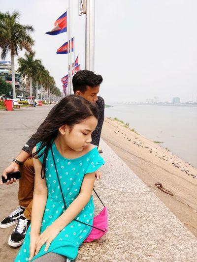 When in Phnom Penh EyeEmNewHere Phnompenh Cambodia Tonlesap Little Girl EyeEm Selects Sea Beach Togetherness Child City Full Length Young Women Childhood Women Summer Calm Posing