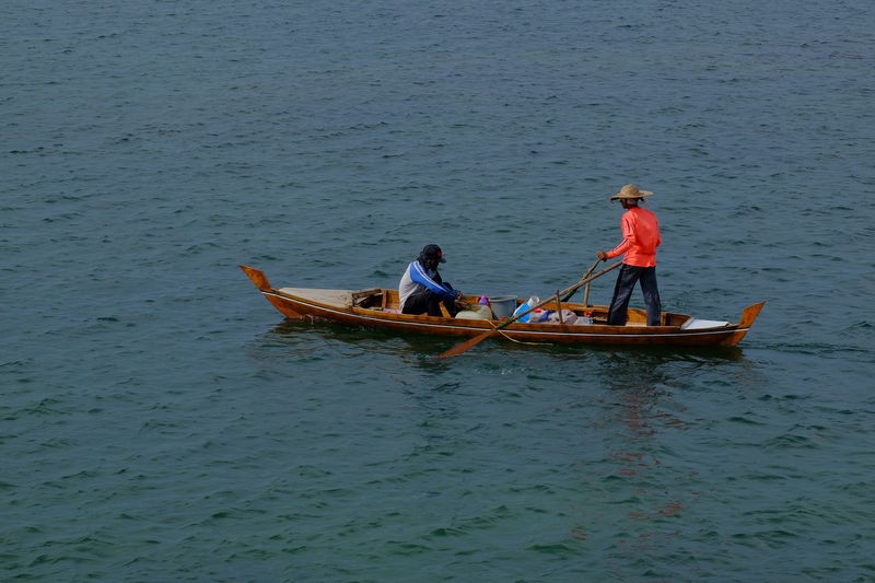 Adult Batam-Indonesia Canoe Classic Chrome Day Fisherman Malay Men Nautical Vessel Ocean Outdoors People Sea Traditional Culture Transportation Two People Water Wooden