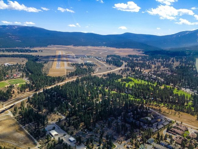 Aerial view of the Truckee Tahoe Airport. Aerial View Airport Blue Sky California Mountain Town Mountains Pine Trees Sierra Nevada Top Perspective Truckee  Valley