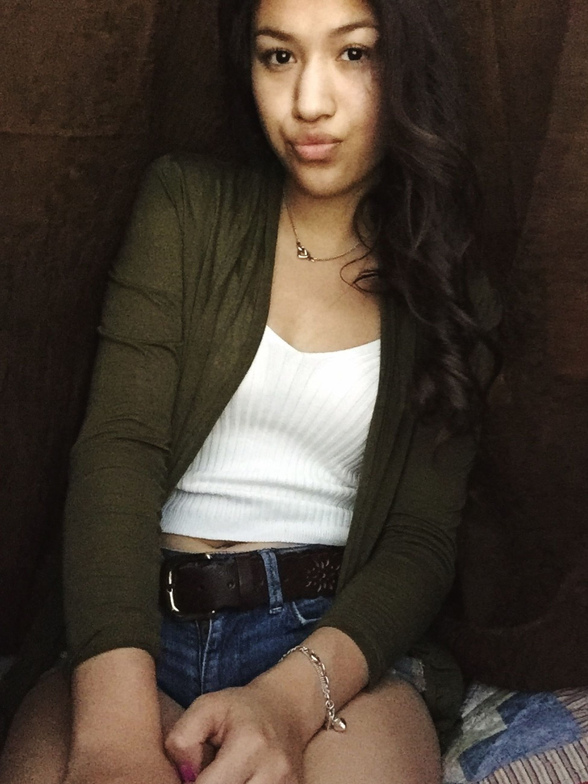 young adult, young women, lifestyles, indoors, front view, person, portrait, long hair, looking at camera, beauty, casual clothing, leisure activity, fashion, sensuality, femininity, black hair, standing