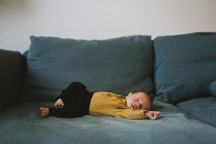 Man lying down on sofa at home