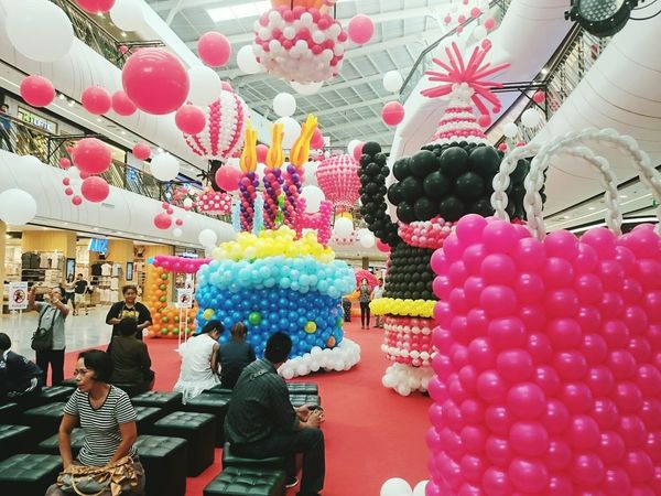 In central plaza.Multi Colored Retail  Variation Abundance Indoors  Large Group Of Objects Celebration Choice Store Balloon Adult Day People Adults Only One Person
