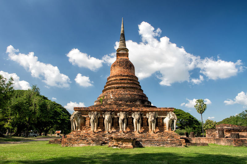 Ancient temples in sukhothai Buddha Architecture Built Structure Sky Belief Religion Place Of Worship Spirituality History The Past No People Building Day Outdoors Ancient Civilization Building Exterior Travel Destinations Cloud - Sky Nature Travel Ancient Tourism Plant Spire  Archaeology
