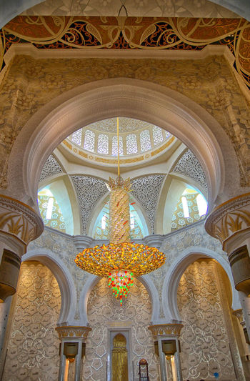 Sheikh Zayed Grand Mosque Arch Architectural Column Architectural Feature Architecture Architecture And Art Belief Building Built Structure Ceiling Chandelier Day Design Floral Pattern History Indoors  Lighting Equipment Low Angle View Mosque No People Ornate Pattern Religion Svarovski Travel Destinations
