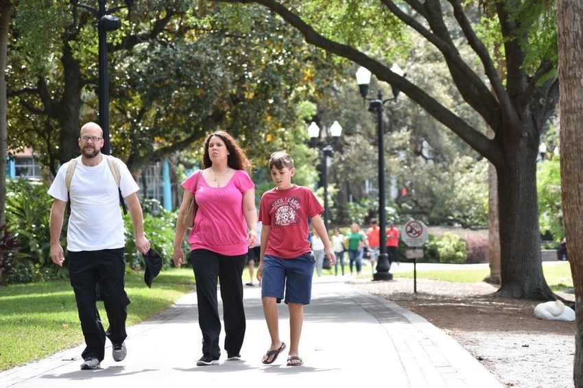 City Downtown Family Kids Lake Eola Park Orlando Path Running Walking Around Adult Day Downtown District Florida Friendship Full Length Jogging Lake Eola Outdoors Park People Summer Togetherness Tree Walking Young Adult