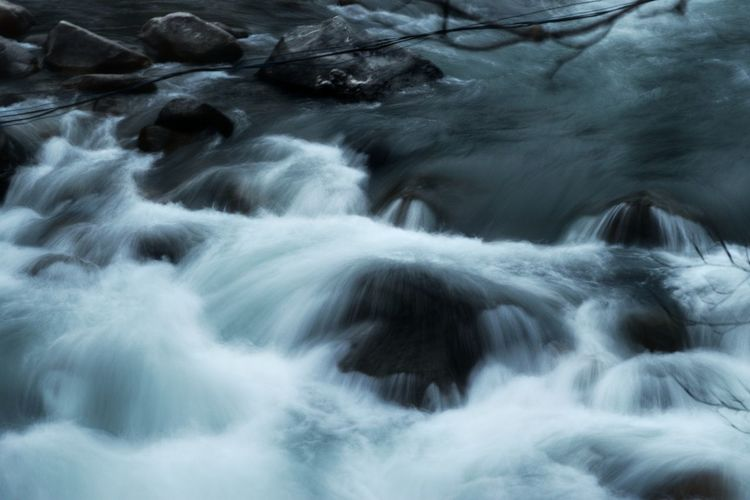 Close-up of water flowing over river