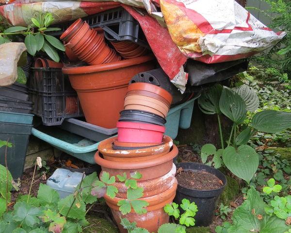 Stacked plant pots Plastic Bag Close-up Garden Equipment No People Outdoors Plantpots Plastic Pots Teracotta Pots