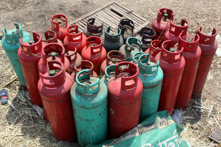 Red High Angle View Container No People Large Group Of Objects In A Row Metal Outdoors Side By Side Choice Multi Colored Cylinder Close-up Variation Gas Gas Cylinder