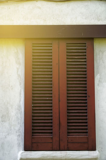 Window in Italy style Window Window Frame Window Box Window Shutters Italy Window Built Structure Architecture Building Exterior Closed Building Day No People Protection Safety Wall - Building Feature Security Entrance Shutter Door Metal Outdoors House Pattern White Color Iron Corrugated Garage
