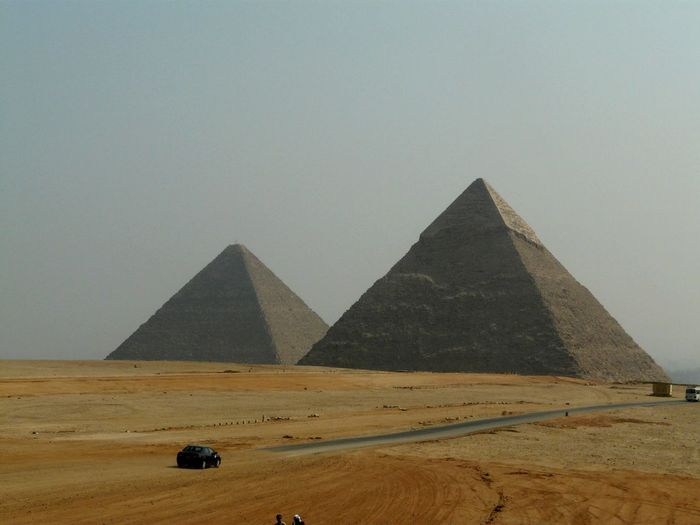 Road by great pyramid of giza against sky