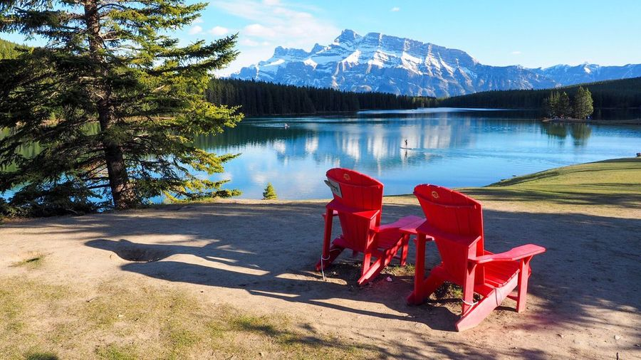 Mountain Lake Tranquil Scene Tree Scenics No People Nature Beauty In Nature Sunlight Day Tranquility Landscape Snow Red Outdoors Water Sky Canadian Rockies  Canada Canada Photos Banff National Park  Two Jack Lake The Great Outdoors - 2017 EyeEm Awards