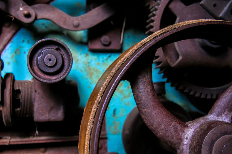 Detail of the machinery of an old mill Metal Machinery Close-up Industry Indoors  Machine Part No People Rusty Equipment Technology Old Factory Focus On Foreground Abandoned Manufacturing Equipment Connection Obsolete Run-down Valve Wheel Metal Industry Mill