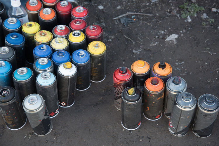 Close-Up High Angle View Of Spray Cans