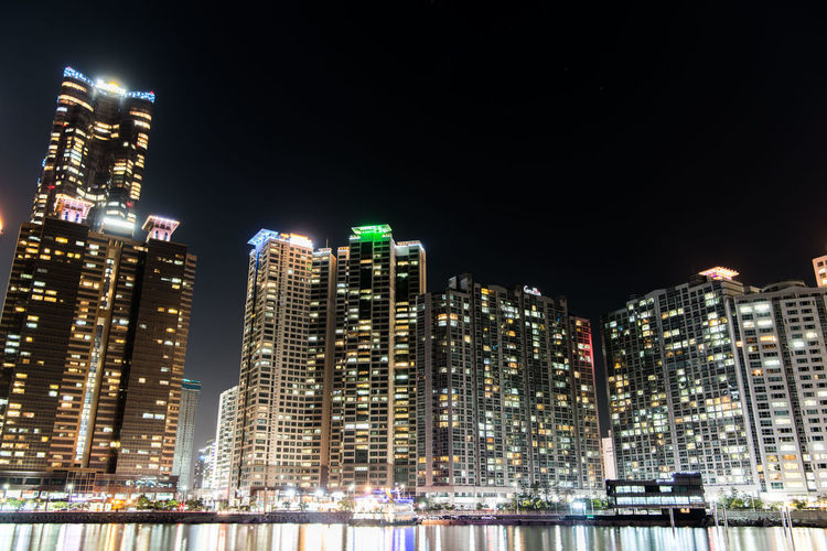 Building Exterior Night Illuminated Built Structure Architecture City Building Office Building Exterior Tall - High Skyscraper Cityscape Modern Sky Urban Skyline Residential District No People Water Nature Landscape Outdoors Financial District  Nightlife