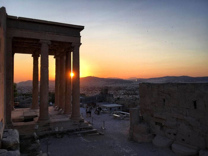 Sunset over Athens Architecture Built Structure Sunset History Old Ruin Architectural Column Sky Ancient Archaeology Orange Color Ancient Civilization The Past Sun Tourism Travel Destinations Sunlight Bad Condition Outdoors Building Exterior No People The Week On EyeEm Athens Walls Architecture Ancient Summer Exploratorium
