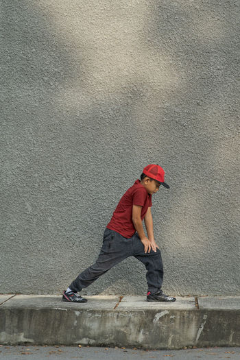 Full length side view of boy on wall