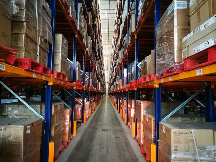 Architecture Built Structure No People Symmetry City Indoors  Day Warehousephotography Business Finance And Industry Storage Warehouse Boxes On Shelf Boxes