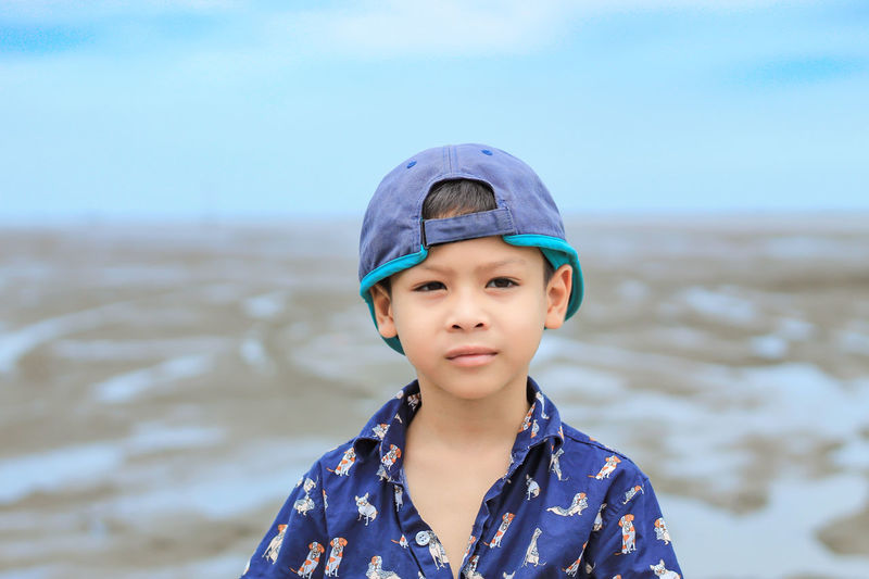 Boy Standing At Beach