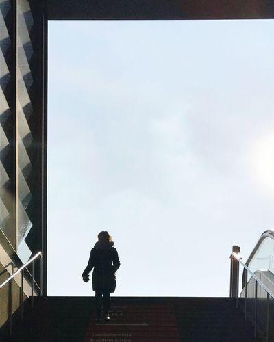 Full length of man walking in city against sky