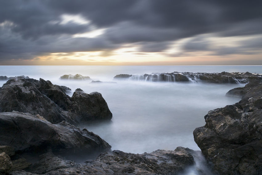 Almería Awe Beach Beauty In Nature Cloud - Sky Cloudscape Coastline Day Dramatic Sky Horizon Over Water Landscape Long Exposure Napatu Nature No People Outdoors Rock - Object Scenics Sea Sky Storm Storm Cloud Waterfall