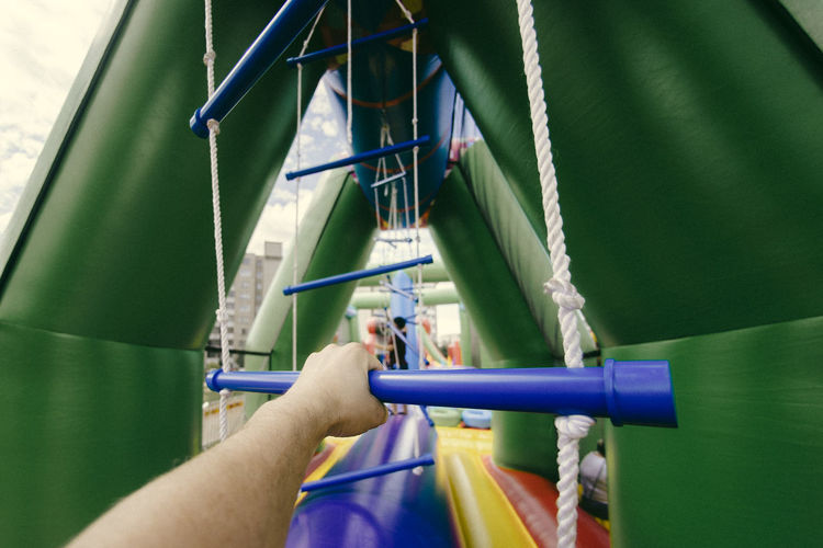Cropped hand in outdoor play equipment