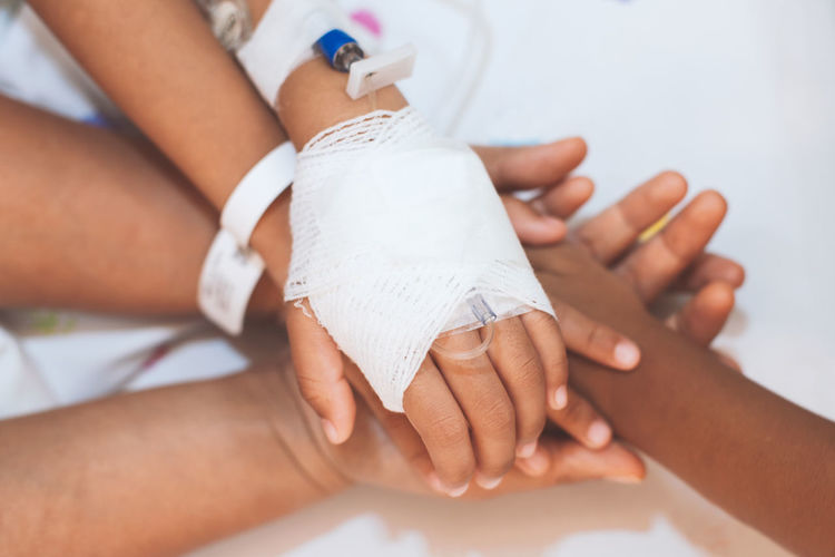 Close-up of children hands with patient stacking in hospital