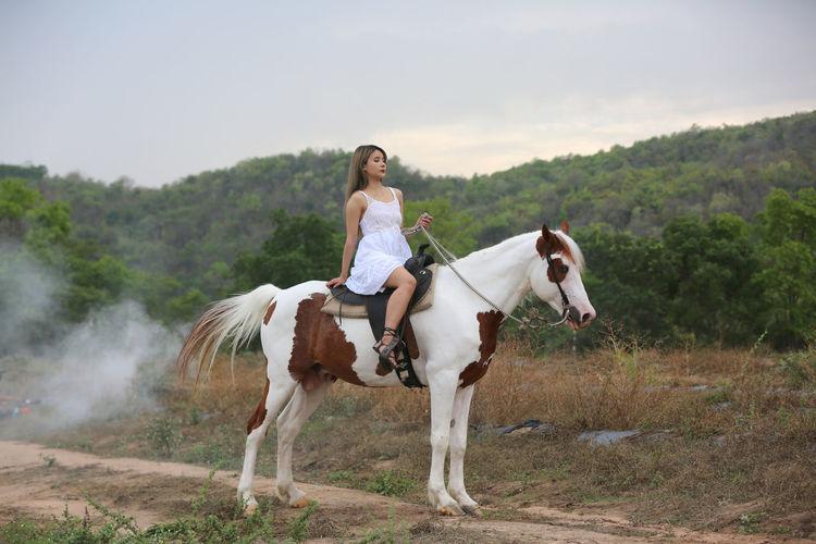 Full length of woman riding